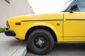 yellow subaru wagon the street peep 1977 subaru dl leone wagon