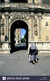two nuns in front of archway decoration in the renaissance style