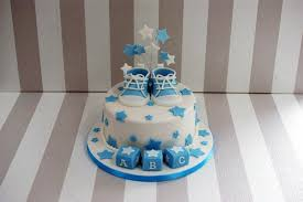 a bow tie and chevron baby shower cake to welcome a sweet little