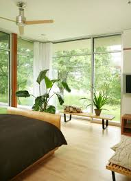 decorate a room with floor ceiling windows