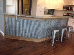 Does Flooring Go Under Cabinets Reclaimed Barn Tin Roofing Used As Wanescoting Under A Bar Cabinet