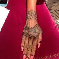 rihanna gets new henna inspired hand tattoo tattoo articles