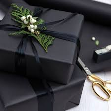everything you need to survive the holidays black wrapping paper