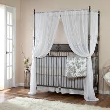 dark gray polished steel pipe baby crib having canopy added white