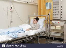 sick bed sick young woman laying in hospital bed with central venous