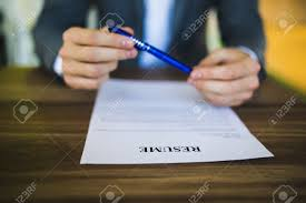Job Seeker Resume by Businessman Or Job Seeker Review His Resume On His Desk Before