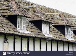 row of black and white timber framed cottages at pembridge stock