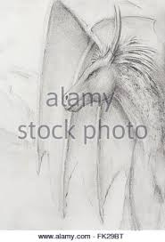 pencil drawing dragon on old paper background stock photo royalty