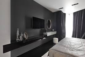 luxury black and white bedroom with classy mirror and ornament
