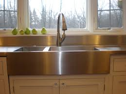 decorating stainless steel apron sink plus silver faucet on white