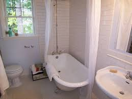 bathroom cool clawfoot tub with rolling curtain in a subway tile