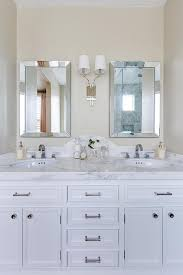 Dual Illuminated Vanity Mirrors Curved Marble Dual Vanity Backsplash With Beveled Mirrors