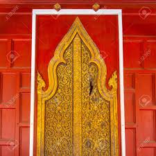 Red Door Paint Thai Wood Carving In The Red Door And Paint With Gold Color Stock
