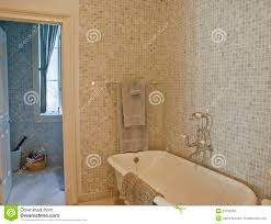 old fashioned tub in mosaic tile bathroom royalty free stock