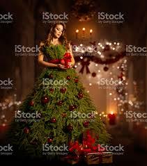 woman christmas tree dress fashion model in xmas gown stock photo