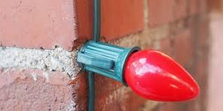 how to use glue to fasten lights to brick or stucco