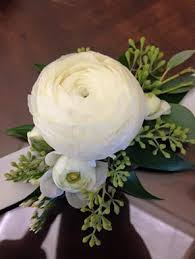 wrist corsage ranunculus with seeded eucalyptus wrist corsage bloomwoods flowers