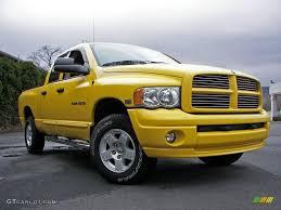 Dodge Ram Yellow - 2005 solar yellow dodge ram 1500 slt quad cab 4x4 7150999 photo
