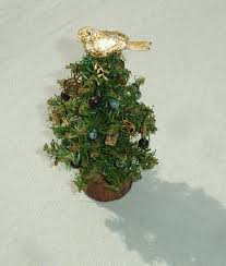 miniature wiccan yule tree with 22 handmade ornaments