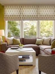 pretty bay window in living room dressed with bold orange and
