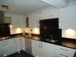 granite countertop hardwood floors with dark kitchen cabinets
