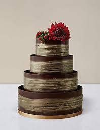 shimmering hoop chocolate wedding cake dark u0026 gold m u0026s