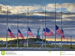 Should Flags Be At Half Mast Flags At Half Staff In Front Of Statue Of Liberty Stock Photo