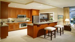 brown laminated wooden kitchen island with cream marble countertop