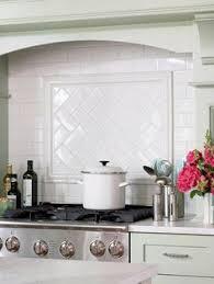 Subway Tile Designs For Backsplash by Gorgeous Simple Hood And Herringbone Pattern Title Backsplash