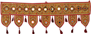 tibetan red toran for the doorstep from kutch with embroidered