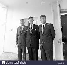 u s president john f kennedy stands with his brothers attorney