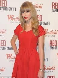 taylor swift wears yet another red dress as she switches on the