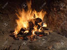 image shows a fire in old fireplace stock photo picture and
