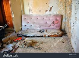 broken couch peeling paint wall abandoned stock photo 49680307