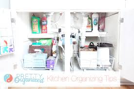 under kitchen sink storage solutions how to organize organize your kitchen