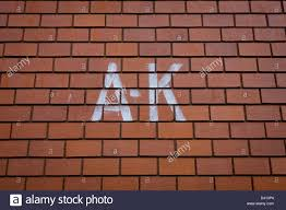 Modern Brick Wall by The Stencilled Letters A K Sprayed On To A Brick Wall Of A Modern