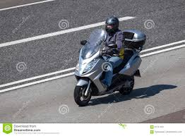 peugeot germany man riding a scooter on the highway editorial stock photo image