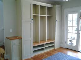 all white mudroom lockerbuilt in shoe storage entryway built