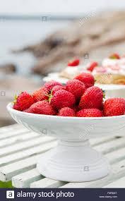 sweden uppland oregrund strawberries in white fruit bowl stock