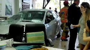4 injured after car crashes into nail salon in hallandale beach