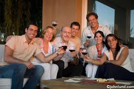 a family gathering toasting with wine for a family portrait