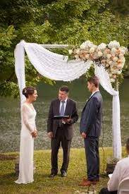 wedding arch lace rustic 2 post wooden arch with asymmetrical florals greens