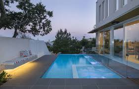 modern pool kit indoor swimming pools design with wall lamps oftb melbourne e2 80 93 landscape architecture swimming pool spa was established in 1995 with a
