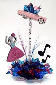 s dance centerpiece with pink tbird retro centerpiece from awesomeeventcom