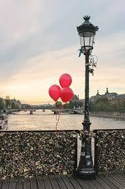 red balloons in paris sunset on the pont des arts paris