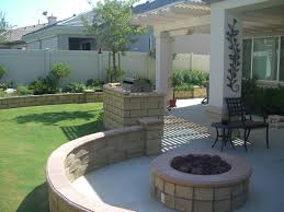 Backyard Fire Pit Ideas by In Demand Rounded Shaped Stone Concrete Fire Pit Ideas As Well As