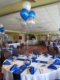 graduation party decorating with balloons party people