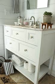 best 25 open bathroom vanity ideas on pinterest farmhouse basement finishing ideas open bathroom vanity with baskets on shelf for storage
