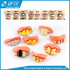 factory price 5cm yellow plastic bucktooth toy for april fools