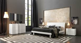 dark gray wall paint bathroom blue carpet on the wooden floor grey end of bed floral